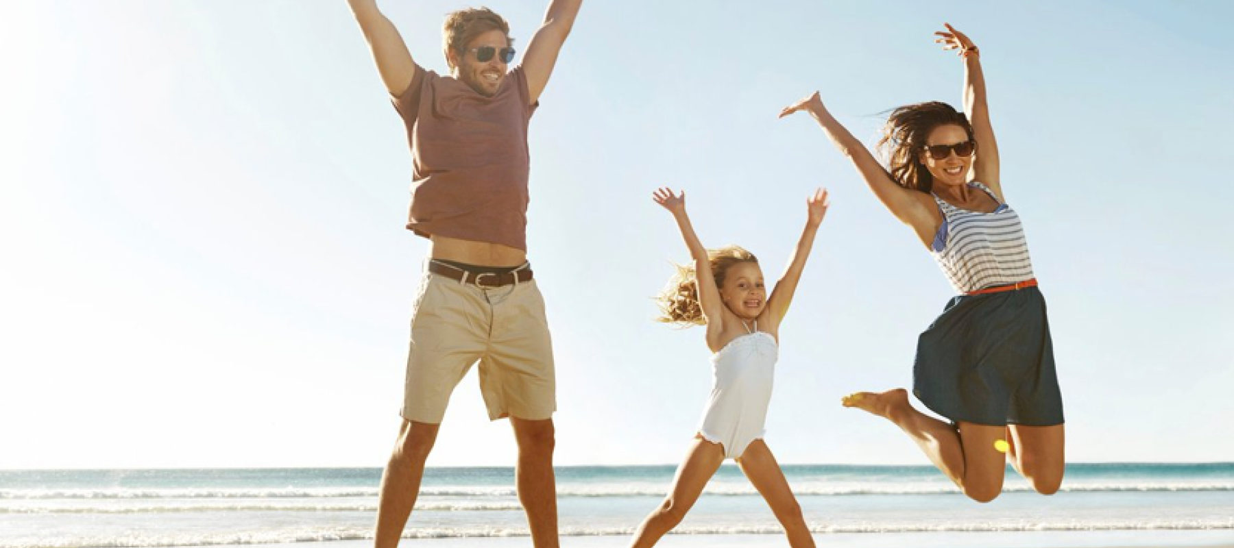 planning family holiday jumping beach stock image